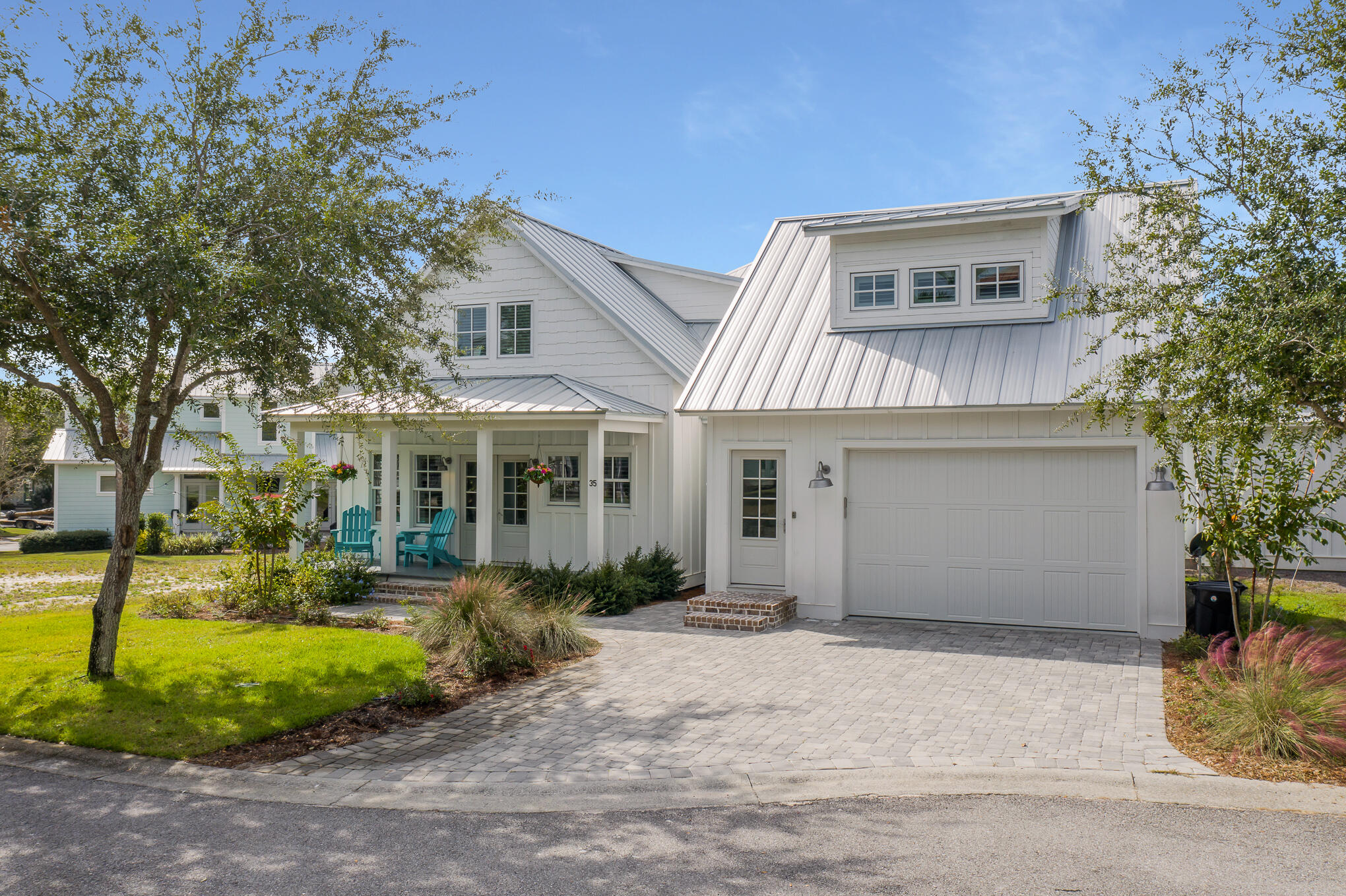 Stunning home in the Village at Blue Mountain Beach with a carriage house! This gorgeous fully furnished 3 bedroom home plus a carriage house sits quietly on the end of the street just off of Hwy 30A and features quartz coutertops, luxury vinyl flooring, gas cooktop, energy efficient LED lighting, stainless steel appliances, and just a short distance to the beach! The neighborhood is gated and has a community pool, shuffle board, and a putting green!This home makes exceptional place to live or a phenomenal investment oppertunity! Don't miss out on this well kept home!