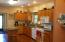Large kitchen with island and granite countertops