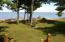 Beautiful back yard on Whitefish Bay with sandy beach
