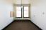 1st office within suite. Windows overlook Ashmun St.