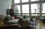 Family Room w/ Floor to Ceiling Windows