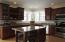 Granite tops with custom cabinet features create a stunning kitchen.