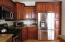 Stainless steel appliances throughout the kitchen.