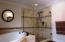 The master bath features a full glass tile shower.