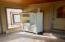 Huge breezeway/mud room with storage area and garage access.