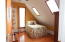 Slanted wall adds character and includes updated skylights!