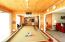 Cedar walls and ceilings create a great game room/ sun room.