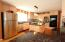The custom kitchen cabinets are enhanced by granite counter tops and stainless appliances.