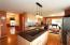 The kitchen opens to the great room, formal dining, casual dining and living room.