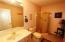 This bath is conveniently located off the great room and just below the 4th bedroom stairway.