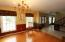 Large windows grace the formal dining room.
