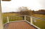 BEAUTIFUL VIEW FROM THE MAIN LEVEL DECK WITH STAIRS LEADING DOWN TO THE PATIO