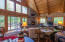 Special features: full wall of windows, stone fireplace and the soaring wood ceilings!