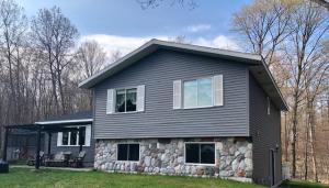 Gorgeous 3 bedroom 2 1/2 bath home on 10 acres. Views of Round Lake.