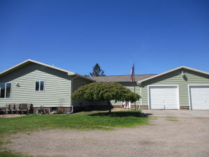 CUSTOM BUILT 3 BEDROOM 2 1/2 BATHS RAISED RANCH HOME SITUATED ON 67 ACRES