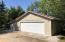2-car garage. Includes wood stove.