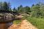 Extensive Betsy River frontage! Camp with three cabins