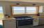 Spacious, u-shaped kitchen with new stainless appliances and granite countertops