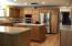 Hardwood floors throughout, custom cabinetry and stainless appliances