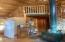 Open-concept living/dining/kitchen with loft detail