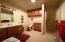 Spacious bathroom with plenty of storage.