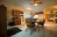 Ceiling fans throughout create a comfortable atmosphere.