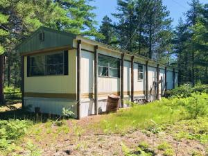 2 bed 1 bath single wide on 5 acres. Take a look! This is a spectacular location.