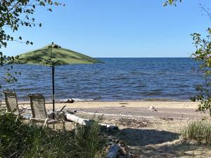 729 feet of beach frontage of Lake Superior on 12+ acres