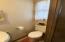1/2 bath in utility/mud room.