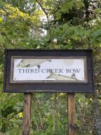 Property is located at the SE corner of the intersection of Whitefish Point Rd and Third Creek Row