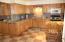 Updated kitchen with custom tile backsplash.
