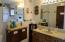 3/4 Bathroom w/Custom Vanity and Cupboards.