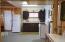 Kitchen includes Gas Range, Refrigerator, Toaster & Microwave.
