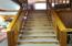 Custom Knotched Handrail Staircase Leading to Loft Bedrooms.