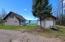 """Back Side of Cottage and Front of 12'4"""" x 44' Garage/Workshop."""