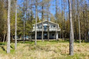 Wooded privacy on both sides of the property.