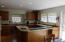 Horseshoe shaped kitchen area with ample storage space.