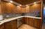 Cabinetry compliments the custom millwork through the home