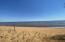 200 Feet of beautiful beach for rockhounding, collecting driftwood and/or enjoying the long summer day.