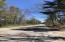 View of Whitefish Point Rd at the gravel drive entrance
