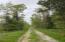 Entry drive on property (runs along south boundary)