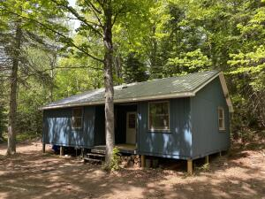Newly renovated cabin with additions on 22 wooded remote acres