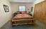 Bedroom 1 includes stackable washer/dryer