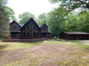 Beautiful log home nestled on a quiet and peaceful wooded 10 acres with hiking trails leading to Monocle Lake and National Forest. Main floor master suite has tiled bath, walk-in shower and walk-in closet. Living room has wood floor, cathedral ceilings, wood stove and stone hearth and chimney. The kitchen has cherry cabinets and granite counter-tops. There is a covered entryway, decks on front and back, a 2+ car garage and storage shed. Hi-efficiency propane furnace and on demand water heater. Lake Superior, Iroquois Lighthouse and beach access nearby. This home provides you the most unique and peaceful UP lifestyle , including high speed internet for those who need to work or be in school from home and it is move in ready! Move in Ready, This Log home will qualify for VA or FHA loans