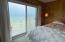 Bedroom with lake views and direct access to lakeside decking