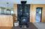 Thoughtfully designed open concept living/dining/kitchen and wood stove with custom stone