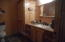Main bath with full tube off hall.
