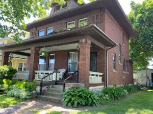 You will be only the 3rd owner of this historic downtown brick stately home , with hardwood floors, brick fireplace , foyer of all original woodwork & doors you'll adore! The mechanics are all updated & you'll appreciate the quaint fenced in backyard with gardens & a pergola to entertain on , 1 car garage & a extra parking space in back , make living on this one way street very accessible and also very low traffic - under $200,000 is a steal in this market - Sellers relocating and happy to work with you on occupancy