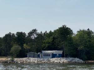 150' of Whitefish Bay frontage with vintage cottage and stone sea wall