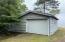 One-car cedar-sided garage with lean-to